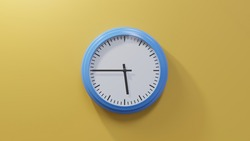 Glossy blue clock on a orange wall at quarter to six. Time is 05:45 or 17:45