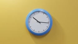 Glossy blue clock on a orange wall at sixteen past ten. Time is 10:16 or 22:16