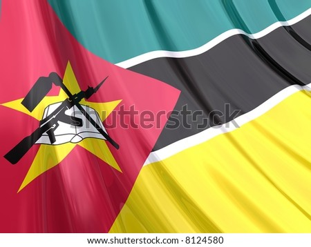 Glossy Flag of Mozambique. The glossy surface of the flag, reflects the ambience.