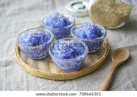 glossy glutinous rice in plastic cup on white background,kaao nieow gaew, Glossy Glutinous Rice.blue #708666301