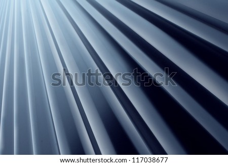 Glossy Metal Radial background made of painted curved aluminum sheet steel looking up as a construction design element for modern architecture and new age outdoor building material.