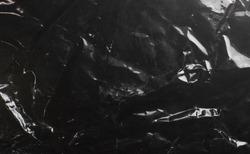 glossy polyethylene on a dark background