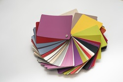 Glossy PVC plastic cards to select the color of furniture lined fan close-up on a white background
