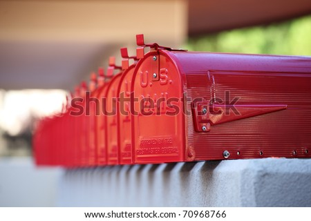 glossy red mailbox repetition in american style and blurred background for mails