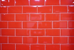 Glossy red tiles wall texture background