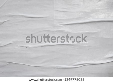 glossy white paper creased lined waved wrinkled weathered empty street poster, space for typography text #1349775035