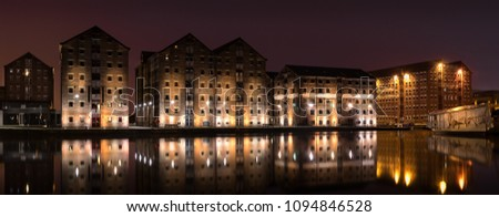 Gloucester Docks at night time with reflections of warehouse