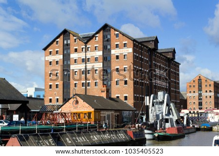 Gloucester, UK - 24th August 2010: A refurbished old Victorian warehouse building in historic Gloucester Docks houses the National Waterways Museum.