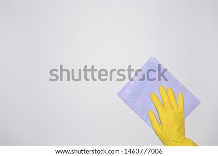 gloved hand washes a rag clean housekeeping household cleaning #1463777006
