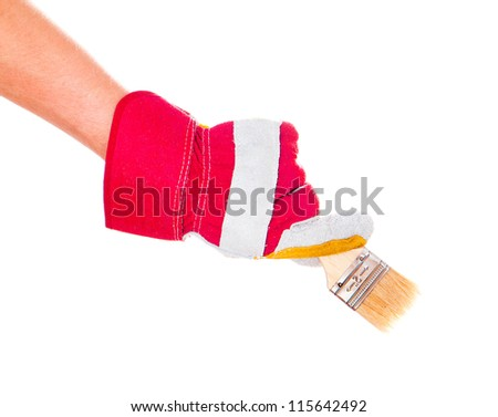 gloved hand with a brush isolated on a white background