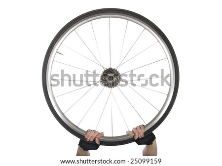 Gloved hands holding up a road bike wheel