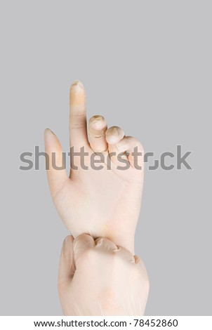 gloves on a hand on a grey background