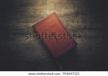Glow illuminating the Holy Bible in the dark.