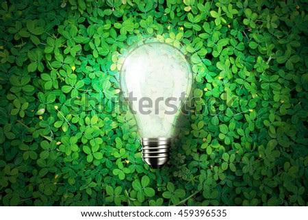 Glow light bulb is on green grass background , concept idea, 3d illustration