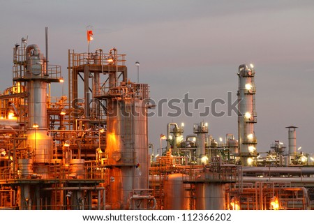 Glow light of petrochemical industry on sunset.