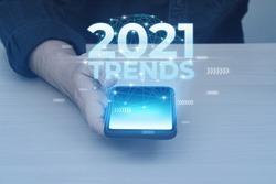 Glow lighting of phone in hands of guy. 2021 year trends in smartphone.