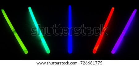 Glow sticks lines on black ambient #726681775
