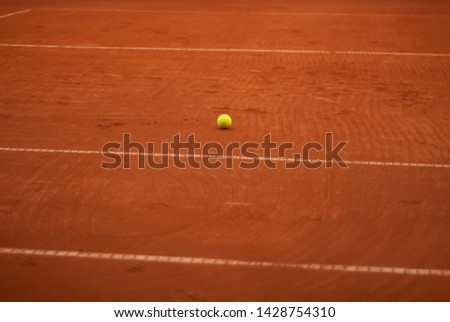 Glow tennis ball on the court. Summer sport and recreation #1428754310