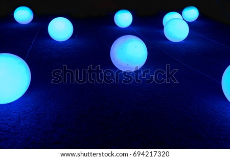 Glowed balls on blue background #694217320