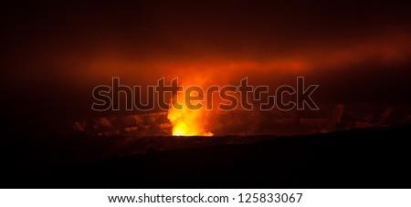Glowing active volcano crater at night , Big Island, Hawaii
