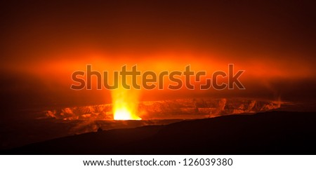 Glowing active volcano crater at night , Big Island, Hawaii