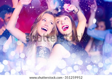 Glowing background against happy friends having fun together #351259952