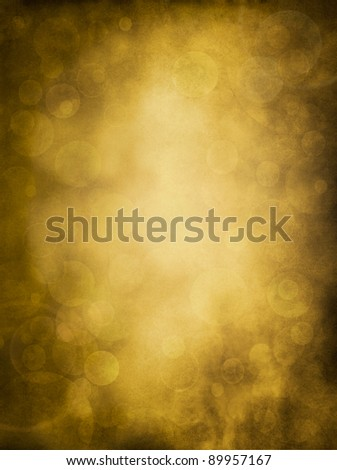Glowing bokeh effects on a textured paper background.  Image has a pleasing grain pattern at 100%.