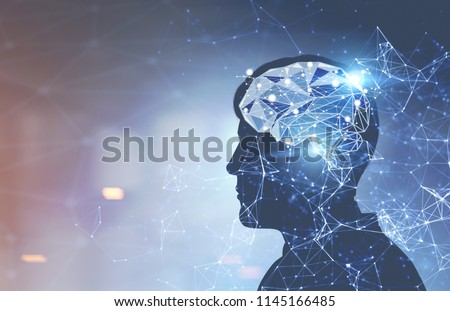 Glowing brain hologram inside a head of a man against a blurred background. Concept of thinking and decision making. Toned image double exposure mock up
