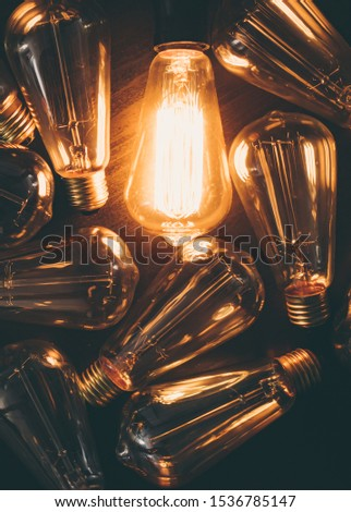 Glowing bulb. Idea, uniqueness, leadership and different concept. Wooden background.