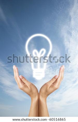 glowing bulb in hands