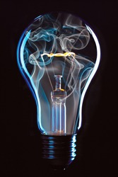 Glowing bulb with blue smoke