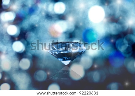 Glowing diamond on blurred background