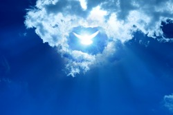 Glowing dove in a blue sky. Faith symbol.