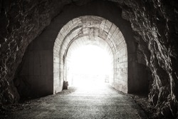 Glowing exit from dark abandoned tunnel