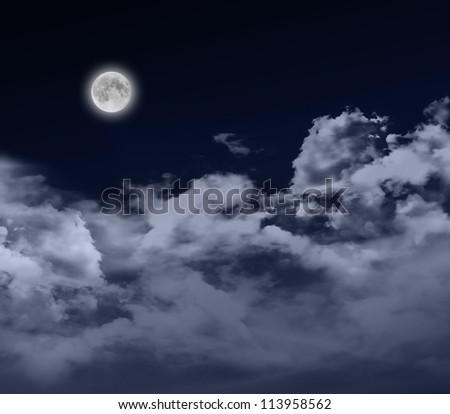 glowing full moon at night with cloudscape