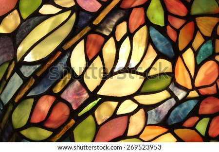 Glowing Glass Art. Backlit hand crafted glass art from church window with flowers and vivid colors.