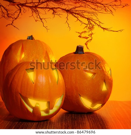 Glowing Halloween pumpkin, warm candle light, autumn holiday background, traditional jack-o-lantern, night party decoration