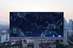 Glowing hologram of technological process on billboard, aerial panoramic cityscape of Kuala Lumpur at sunset. KL is the largest innovative hub of tech services in Malaysia, Asia.