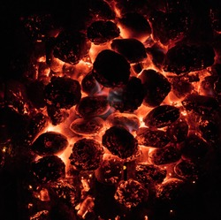 Glowing Hot Charcoal Briquettes on garden grill, close-Up, Top View