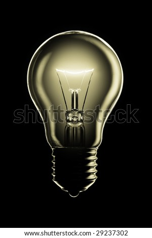 Glowing lamp on black background - stock photo