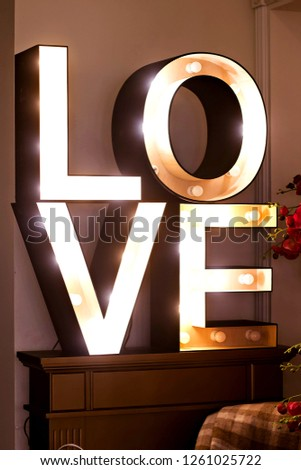 """Glowing letters of the word """"love"""".  Large glowing letters """"Love."""" Interior decor"""