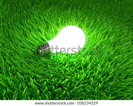 Glowing light bulb hanging above grass symbol of ecological energy
