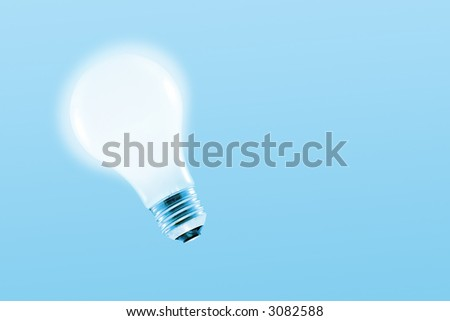 Glowing light bulb on a light blue background