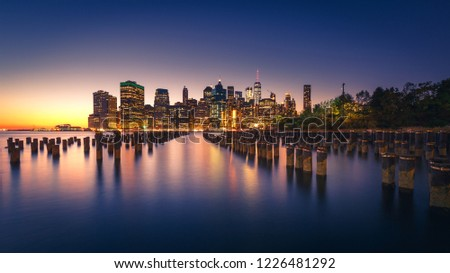 Glowing Manhattan skyline from Brooklyn. New York City with light relections on Hudon Bay #1226481292