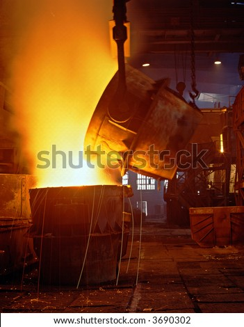 Glowing, molten hot steel. Stell casting.