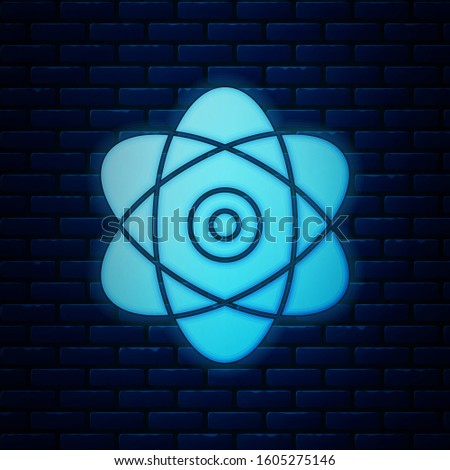 Glowing neon Atom icon isolated on brick wall background. Symbol of science, education, nuclear physics, scientific research. Electrons and protons sign.