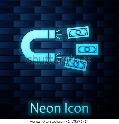 Glowing neon Magnet with money icon isolated on brick wall background. Concept of attracting investments, money. Big business profit attraction and success