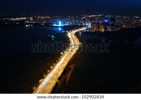 glowing night road to the city