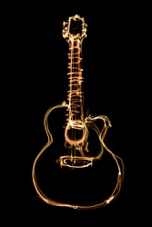 glowing orange outline of an acoustic guitar on a black background. freeze light photo