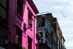Glowing Pink Colour House with Sunlight in Urban Setting, London UK